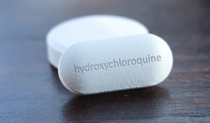 A Close-up Look Of White Hydroxychloroquine Tablets Placed On The Table.