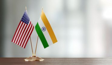 Indian And United States Table Flags Placed On The Table.
