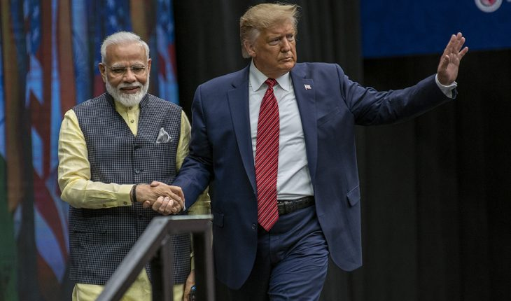 Narendra Modi & Donald Trump Walking Towards The Crowd By Holding Hands.