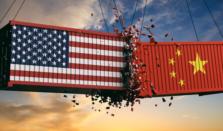 USA And Chinese Flags Crashed Containers On Sky At Sunset Background Representing The Trade War.